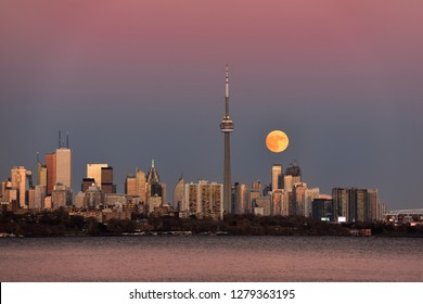 Red supermoon rising over Toronto skyline with pink and blue sky Toronto, Ontario, Canada - November 13, 2016