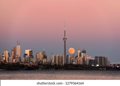 Red supermoon rising over Toronto cityscape on Toronto, Ontario, Canada - November 13, 2016
