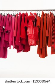 red sweater, pink shirt with colorful clothes ,coat, sundress on a hanger