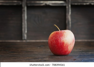 Red sweet apple on the wooden table, selective focus