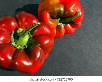 Red sweet bell pepper on the table. Closeup.  Copy spaces.