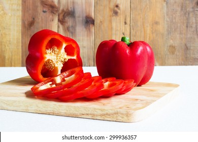Red sweet pepper on a chopping board.