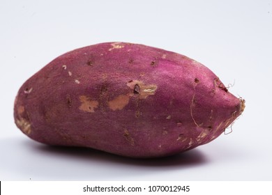 Red sweet potato isolated on white  - Shutterstock ID 1070012945