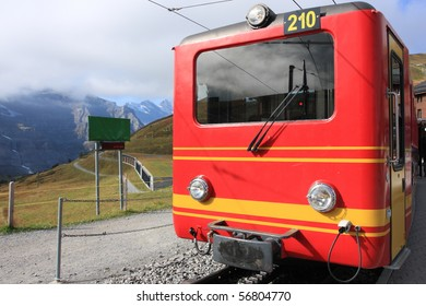red Swiss train heading to Jungfraujoch