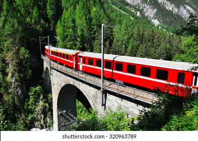 Red swiss train on viaduct, Switzerland