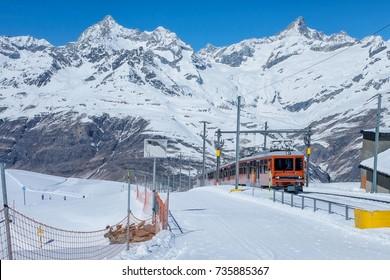 A Red swiss train in the railway from Interlaken to Jungfraujoch, Switzerland