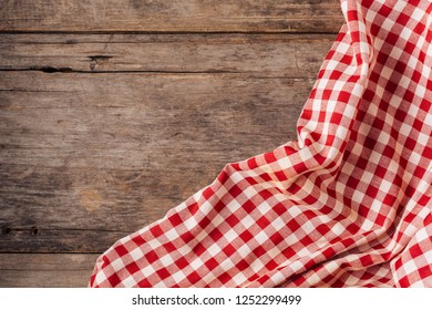 red table cloth on old wooden background
