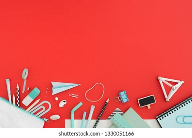 Red table and school supplies. Creative workspace. Flat design.