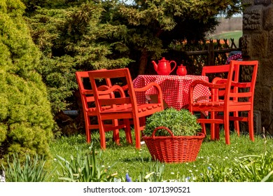 Red tablecloth is in the garden