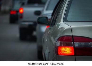 red tail light brake of stop car on road traffic jam
