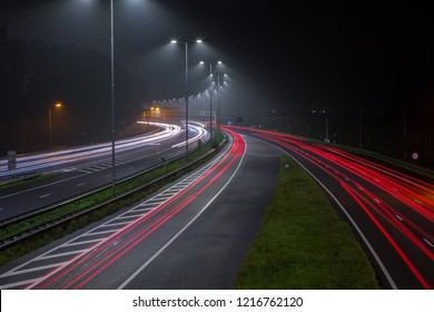Red tail lights on the A2 highway at night out of Amsterdam