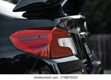 Red Taillight on Black Vehicle