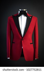 Red tailored suit, tuxedo isolated on black background on mannequin