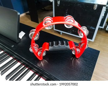 Red tambourine. An ancient musical instrument.