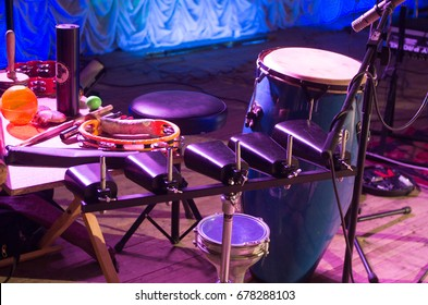 Red tambourine And other musical instruments. Musical instruments on the stage.