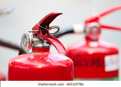 Red tank of fire extinguisher.