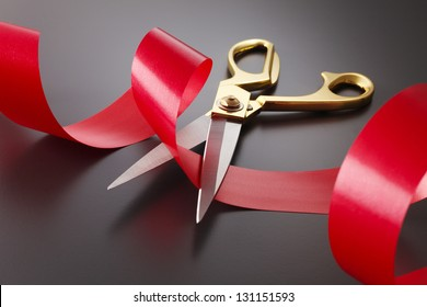 Red Tape is going to be cut by a pair of sissors for an Opening