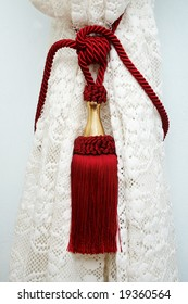 Red tassel on the drapery