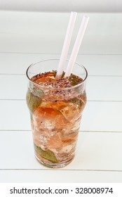red tea cold with ice and mint