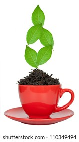 Red tea cup with the leaves