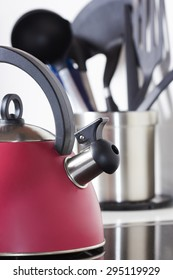 red tea on a background of kitchen utensils, teapot