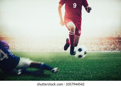 red team soccer footballer dribbling the ball pass blue team in the stadium