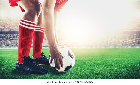 red team soccer footballer get the ball to free kick or penalty kick during match in the stadium