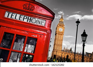 Red telephone booth and Big Ben in London, England, the UK. The symbols of London on black on white sky.