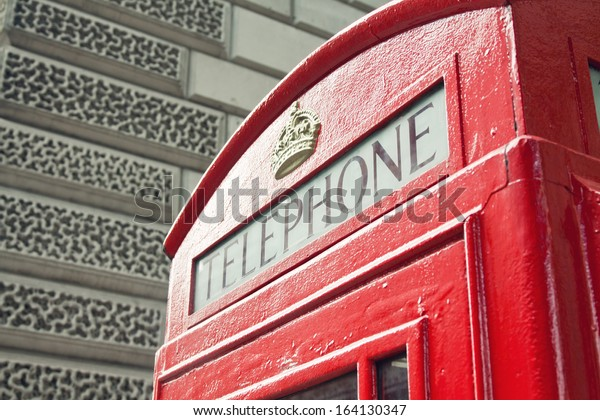 Red Telephone Booth in London street day time