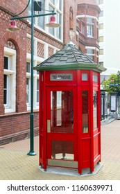 Red telephone booth at the street in Christchurch, New Zealand