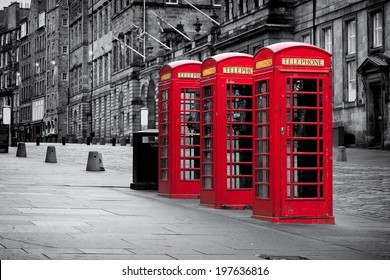 Red telephone booths along the famous royal mile in black and white in Edinburgh, capital of Scotland, United Kingdom