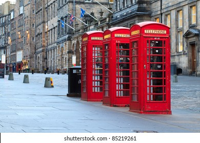 Red telephone booths along the famous royal mile in Edinburgh, capital of Scotland