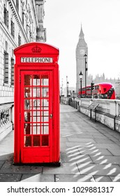 Red telephone box and Big Ben in London.