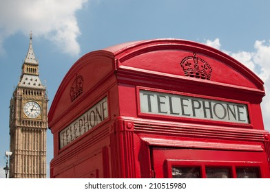 Red telephone box with Big Ben in parliament square London, UK. Photo taken on the 28th of July 2014.