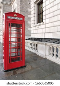 Red telephone box in London, beyond building. Great Britain