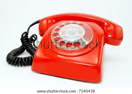 Red telephone isolated on white background.