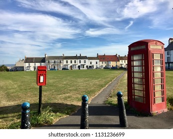 Red telephone and post box by village green, Seaton Carew, Hartlepool, England