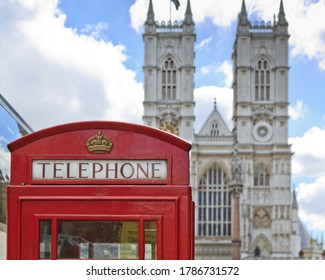 Red Telephonebooth with Westminster Abbey in the back