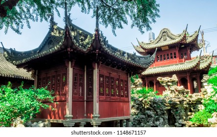 Red temple, traditional chinese buildings and rocks at Yu Gardens, Shanghai, China