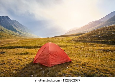 Red tent in the mountain valley of Kyrgyzstan