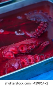 Red tentacles of an octopus at a street market in Tokyo, Japan.