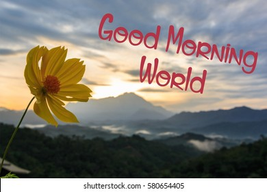 """Red text """"Good Morning World""""  with yellow flower and blur Mount Kinabalu as background"""