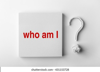 Red text Who Am I and paper question mark with white background.