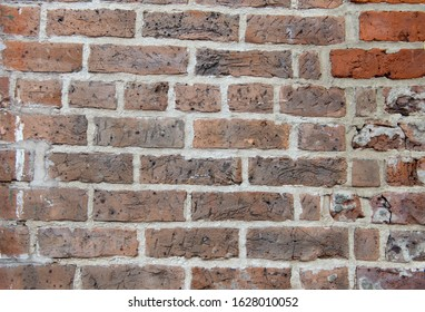 Red Textured Brick Wall with holes, paint