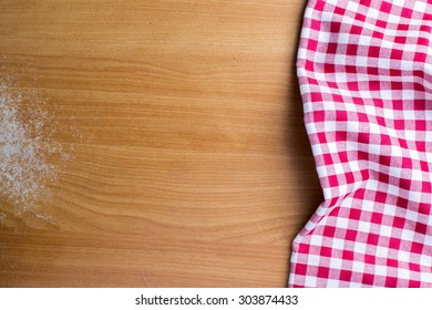 red textured cloth on wood background