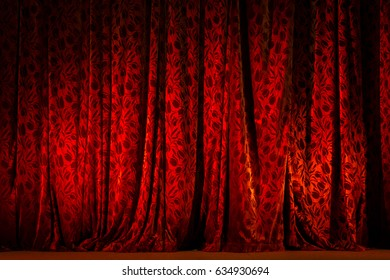 Red Theater Curtain illuminated with spot light