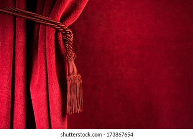 Red theatre curtain and red tassels