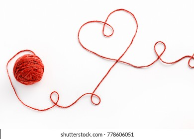 Red thread and tangle. Valentine's Day