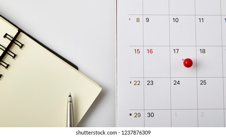 Red thumbtack a date 17th on calendar or planner. Tax Day 2018 takes place on April 17. selective focus