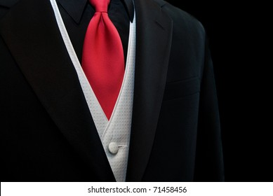red tie accenting a black tuxedo